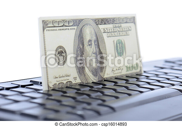 concept for online shopping or banking with one hundred dlooar bill on a keyboard isolated white background - csp16014893