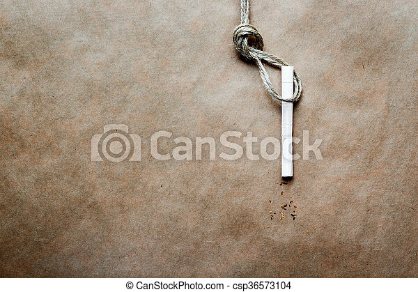 concept hangman's knot on kraft paper background with cigarette - csp36573104