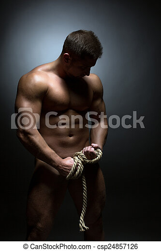 Concept of bodybuilding. Nude man with torn rope - csp24857126