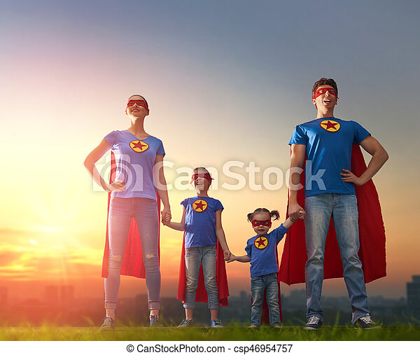 c673b347d Mother, father and their daughters are playing outdoors. mommy, daddy and  children girls in an superhero's costumes. concept of super family.