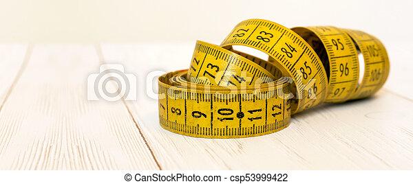 Salud, concepto de dieta: cinta métrica - csp53999422