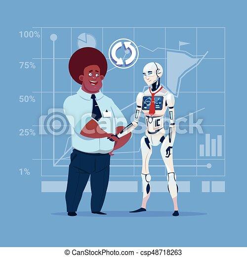 Hombre de negocios afroamericano y robot moderno estrechando manos concepto de cooperación de inteligencia artificial - csp48718263