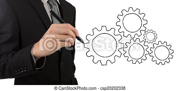 El hombre de negocios dibujando engranajes al concepto de éxito - csp20202338