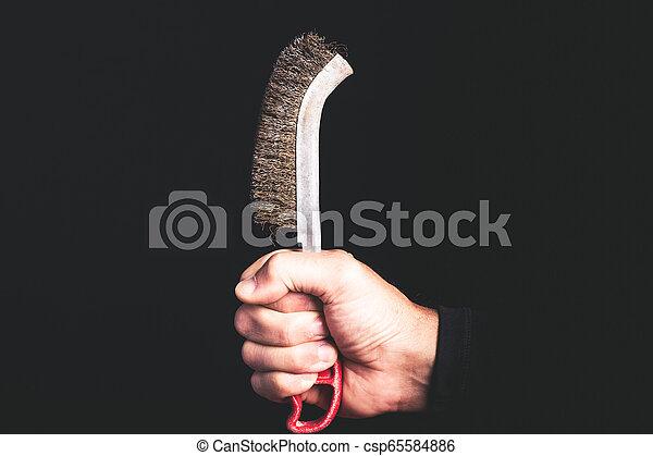 Cepillos - herramientas en un hombre mano - concepto de mantenimiento de la sercice - csp65584886