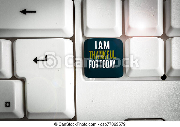 Conceptual hand writing showing I Am Thankful For Today. Business photo showcasing Grateful about living one more day Philosophy White pc keyboard with note paper above the white background. - csp77063579