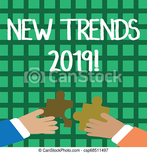 Conceptual hand writing showing New Trends 2019. Business photo showcasing general direction in which something is developing Hands Holding Jigsaw Puzzle Pieces about Interlock the Tiles. - csp68511497