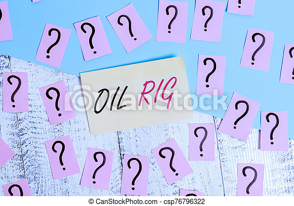 Conceptual hand writing showing Oil Rig. Business photo text large structure with equipment to remove oil from under the seabed Crumbling papers with thick cardboard on the wooden table. - csp76796322