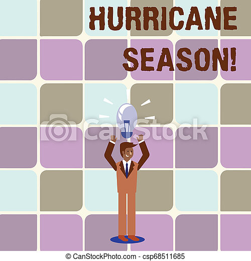Conceptual hand writing showing Hurricane Season. Business photo text time when most tropical cyclones are expected to develop Businessman Raising Arms Upward with Lighted Bulb icon above. - csp68511685