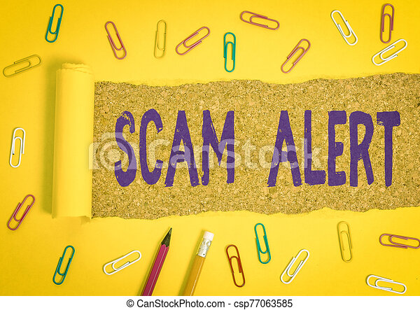Conceptual hand writing showing Scam Alert. Business photo text warning someone about scheme or fraud notice any unusual Stationary and torn cardboard on a wooden classic table backdrop. - csp77063585