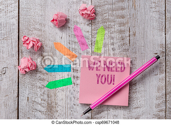 Conceptual hand writing showing We Need You. Business photo text asking someone to work together for certain job or target Note paper and line arrow stickers on the top of wooden table desk. - csp69671048