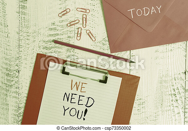 Conceptual hand writing showing We Need You. Business photo showcasing asking someone to work together for certain job or target Colored clipboard paper sheet pencil clips wooden background. - csp73350002