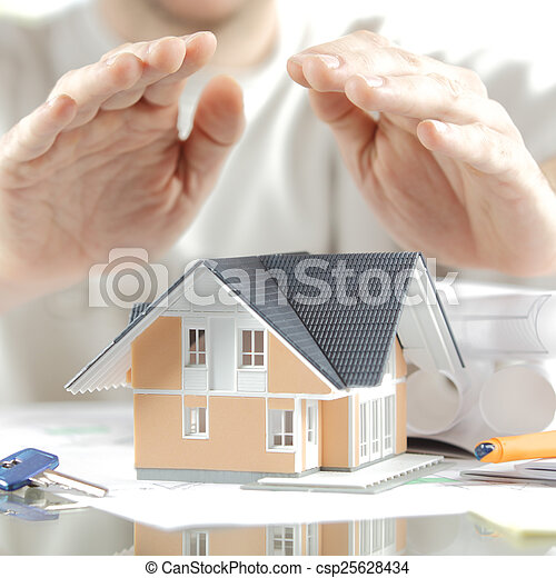 Conceptual Hands Over Miniature House on the Table - csp25628434