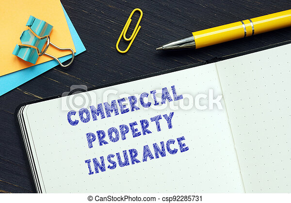 Conceptual photo about COMMERCIAL PROPERTY INSURANCE with handwritten text. - csp92285731