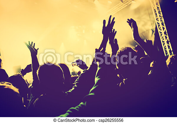 Concert, disco party. People with hands up in night club. - csp26255556