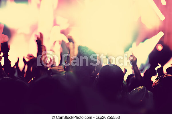 Concert, disco party. People with hands up in night club. - csp26255558