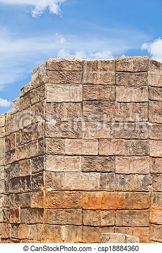 Concrete block wall with blue sky.  - csp18884360