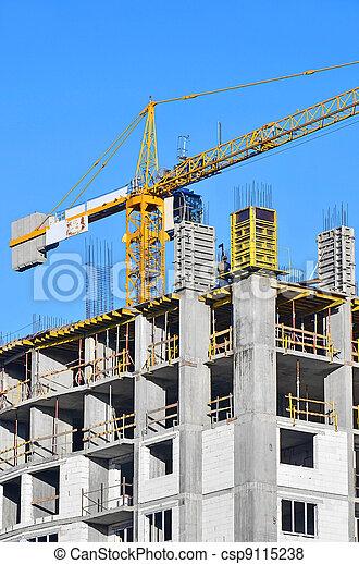 Concrete formwork and crane on construction site - csp9115238