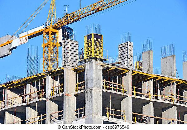 Concrete formwork and crane on construction site - csp8976546