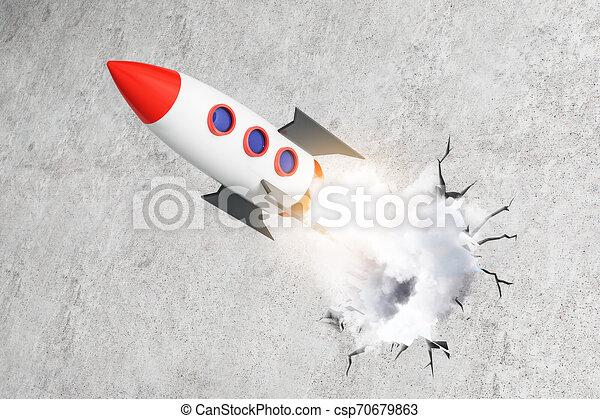 Lanzando cohetes sobre fondo de concreto - csp70679863