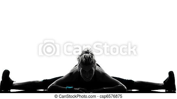 Una postura de ejercicio femenino - csp6576875
