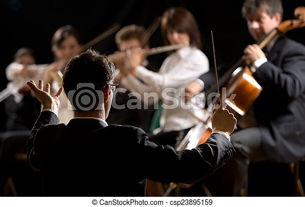 Conductor directing symphony orchestra - csp23895159
