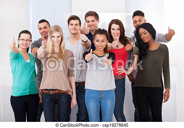 Confident College Students Gesturing Thumbs Up - csp19278645