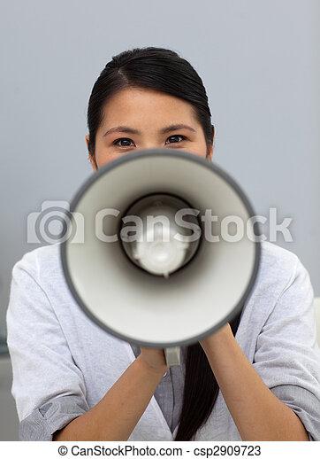 Confident ethnic businesswoman yelling instructions  - csp2909723