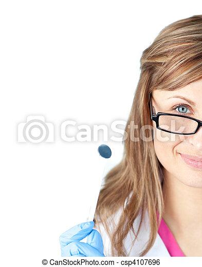 Confident female dental surgeon holding  a speculum - csp4107696
