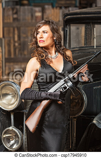 Confident gangster woman with gun. Confident 1920s vintage ...