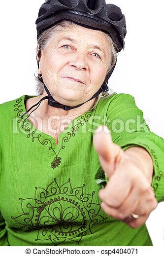 Confident old senior cyclist woman - csp4404071