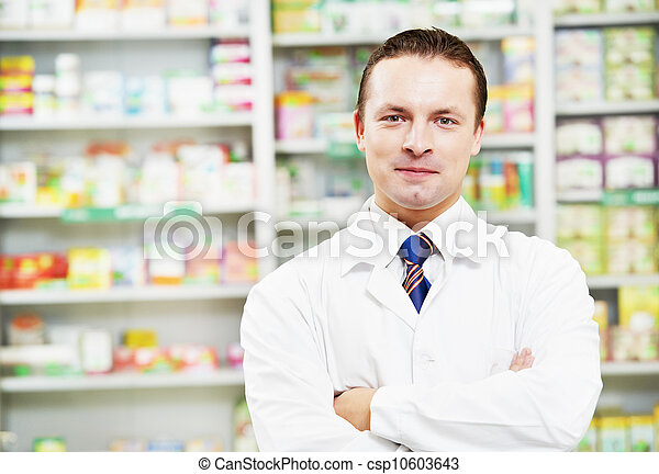 Confident pharmacy chemist man in drugstore - csp10603643