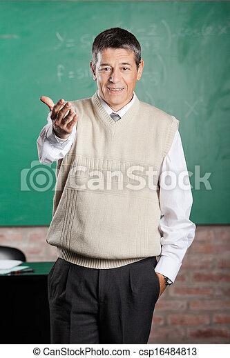 Confident Professor Gesturing In Classroom - csp16484813