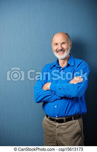 Confident senior male teacher - csp15613173