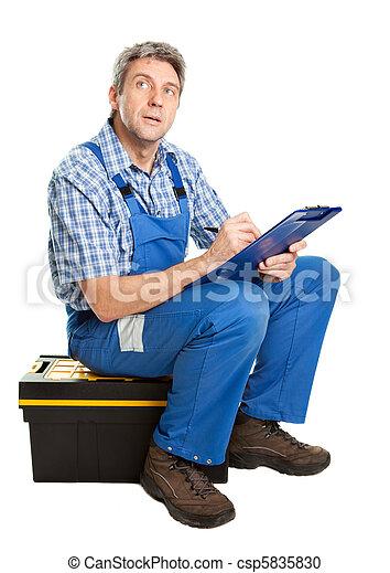 Confident service man taking notes - csp5835830