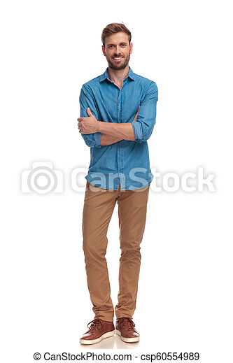 confident smiling casual man with hands crossed