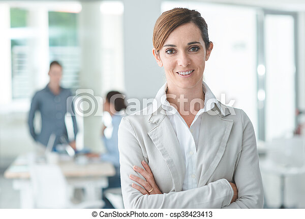 Confident woman entrepreneur posing in her office - csp38423413