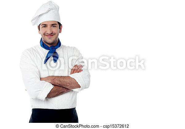 Confident young cook posing in uniform - csp15372612