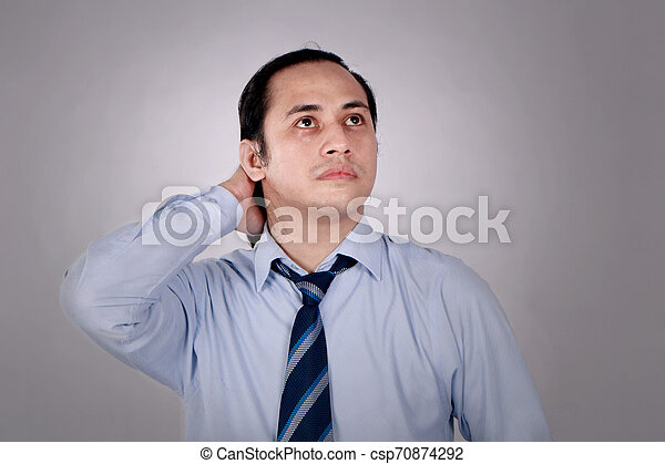 Confused Businessman Thinking Expression - csp70874292