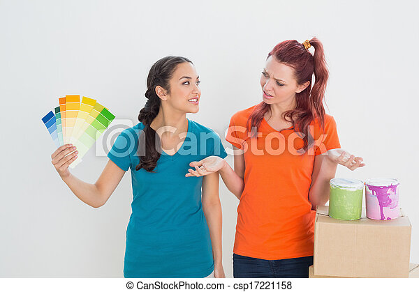 Confused friends choosing color for painting a room - csp17221158