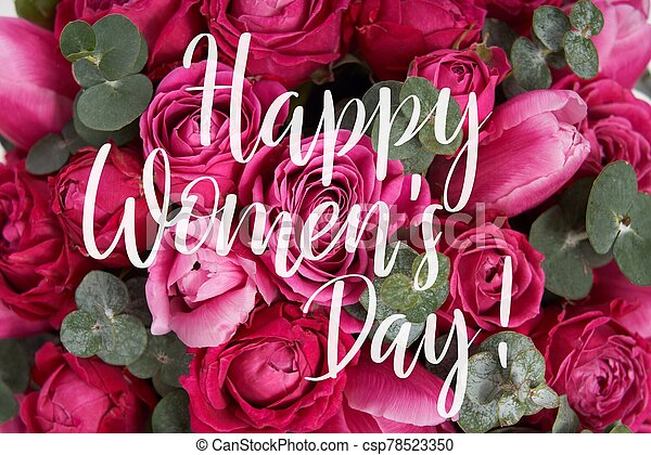 Congratulation text of Happy Women's Day over beautiful bright pink roses and tulips background - csp78523350