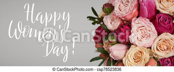 Congratulation text of Happy Women's Day over beautiful bright pink roses and tulips background - csp78523836