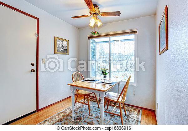 Un pequeño comedor con una mesa rústica - csp18836916