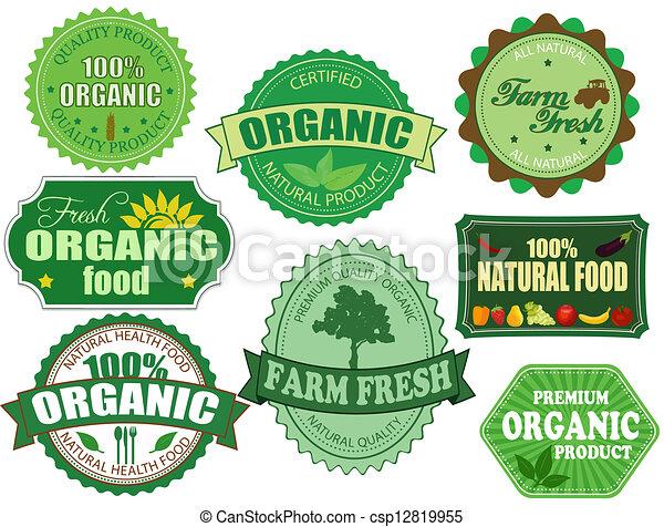 Un conjunto de placas orgánicas y de alimentos frescos y etiquetas - csp12819955