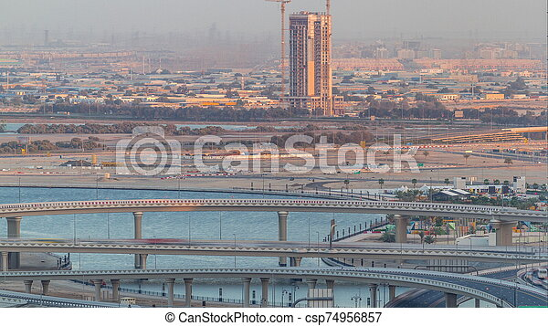Construction and intersection near Dubai Creek Harbor aerial timelapse. Dubai - UAE. - csp74956857