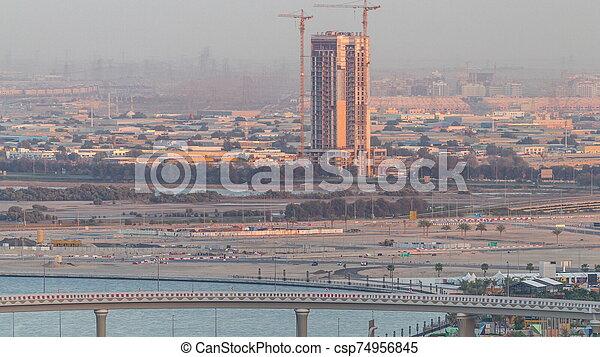 Construction and intersection near Dubai Creek Harbor aerial timelapse. Dubai - UAE. - csp74956845