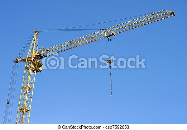 Construction crane on blue sky background - csp7592653
