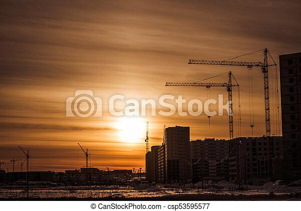 Construction cranes and construction of multi-storey building - csp53595577