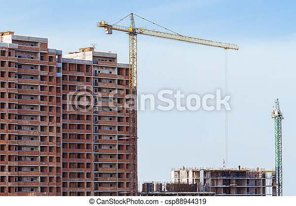Construction, cranes. Tower cranes and modern buildings under construction - csp88944319