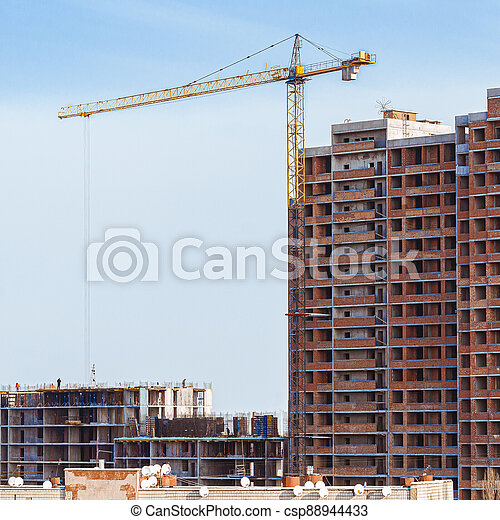 Construction, cranes. Tower cranes and modern buildings under construction - csp88944433