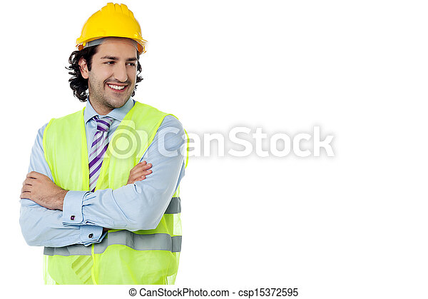 Construction engineer smiling confidently - csp15372595